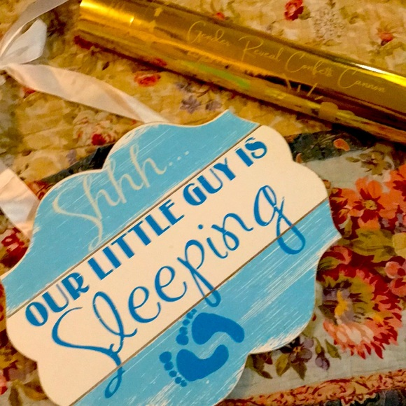 Gender reveal cannon and wood sleeping baby sign